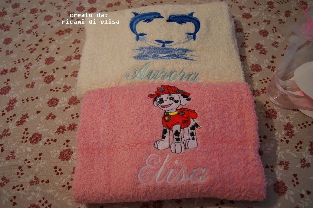 Fireman dog and dolphin designs embroidered on bath towels
