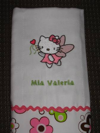 Bath towel with embroidered Hello Kitty on it