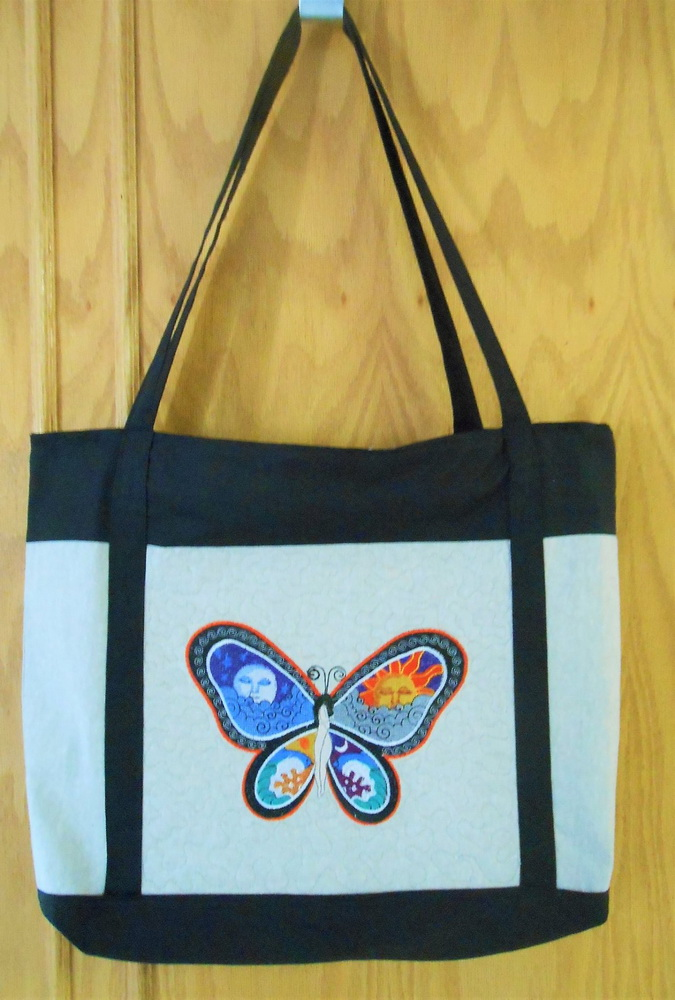 Night and Day butterfly embroidered on white summer bag