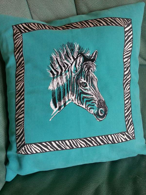 Sofa cushion with zebra embroidery design