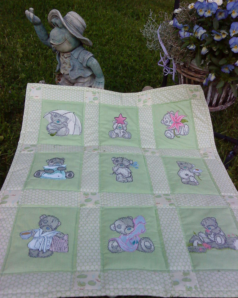 Teddy bear designs on embroidered quilt