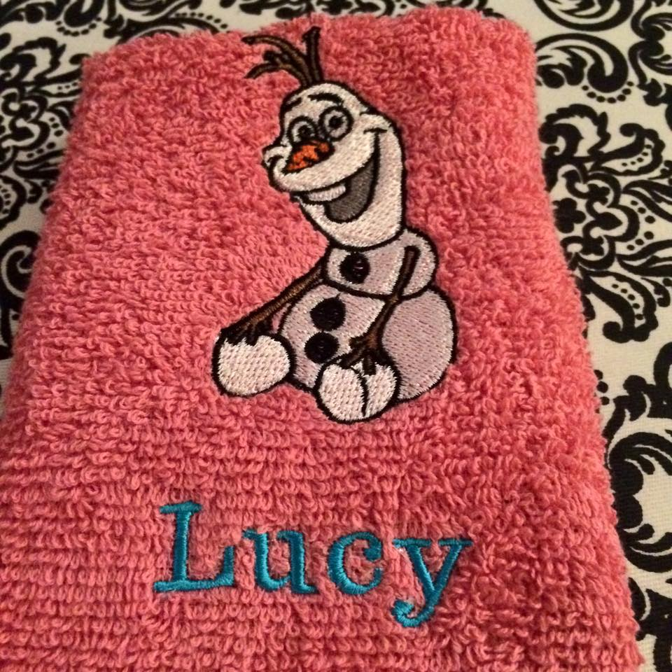 Happy Olaf  design on towel embroidered