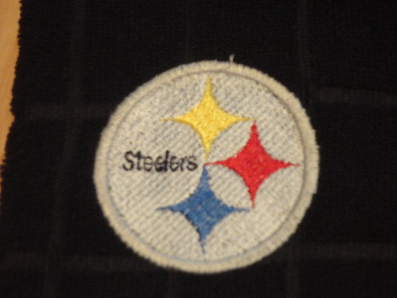 Embroidered Pittsburgh Steelers logo on towel