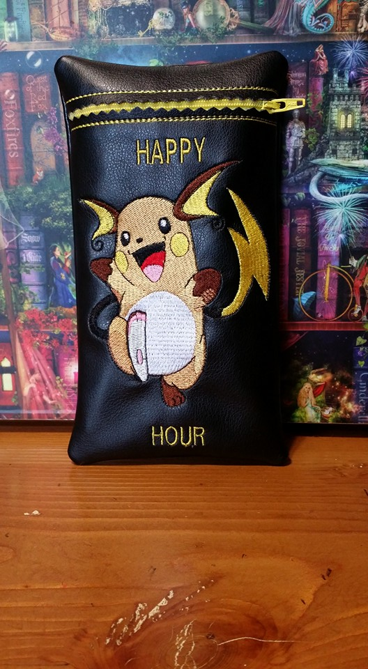 Raichu design on small black leather bag embroidered