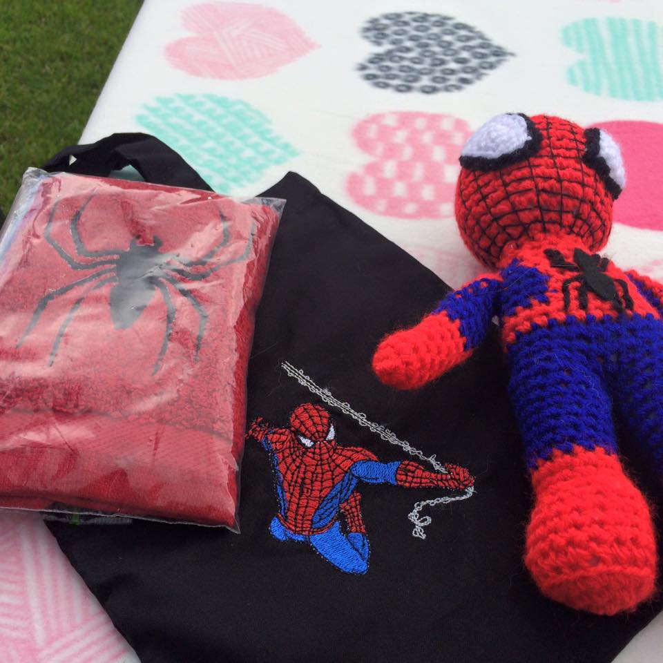 Spiderman on embroidered black textile bag
