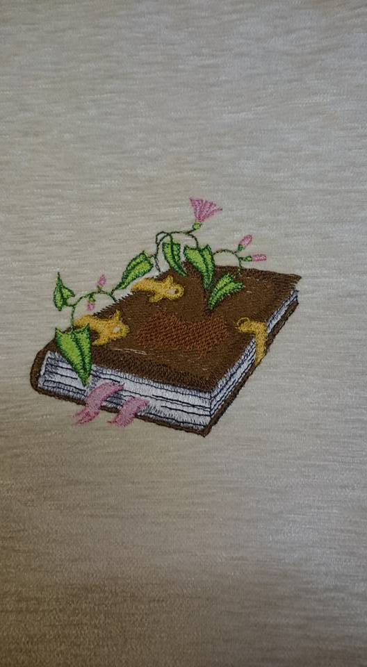 Magic book design embroidered