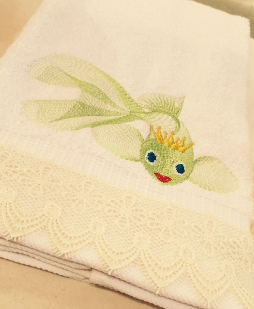 Towel with gold fish embroidery