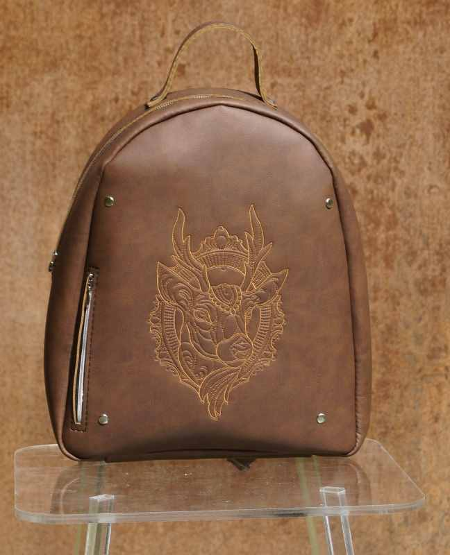 Leather backpack with deer head embroidery design