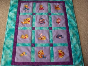 Purple baby quilt with embroidered Tigger, Eeyore, Piglet and Pooh