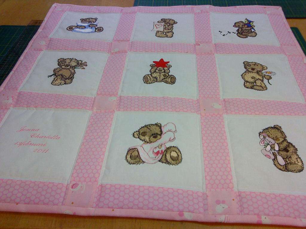 Girl quilt with embroidered bears