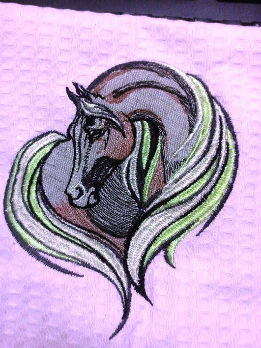 Kitchen towel embroidered with horse design