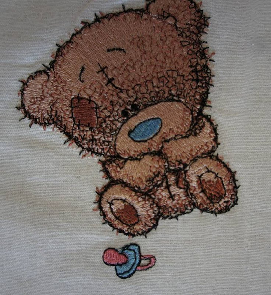 Tiny Teddy bear with children's dummy  design embroidered