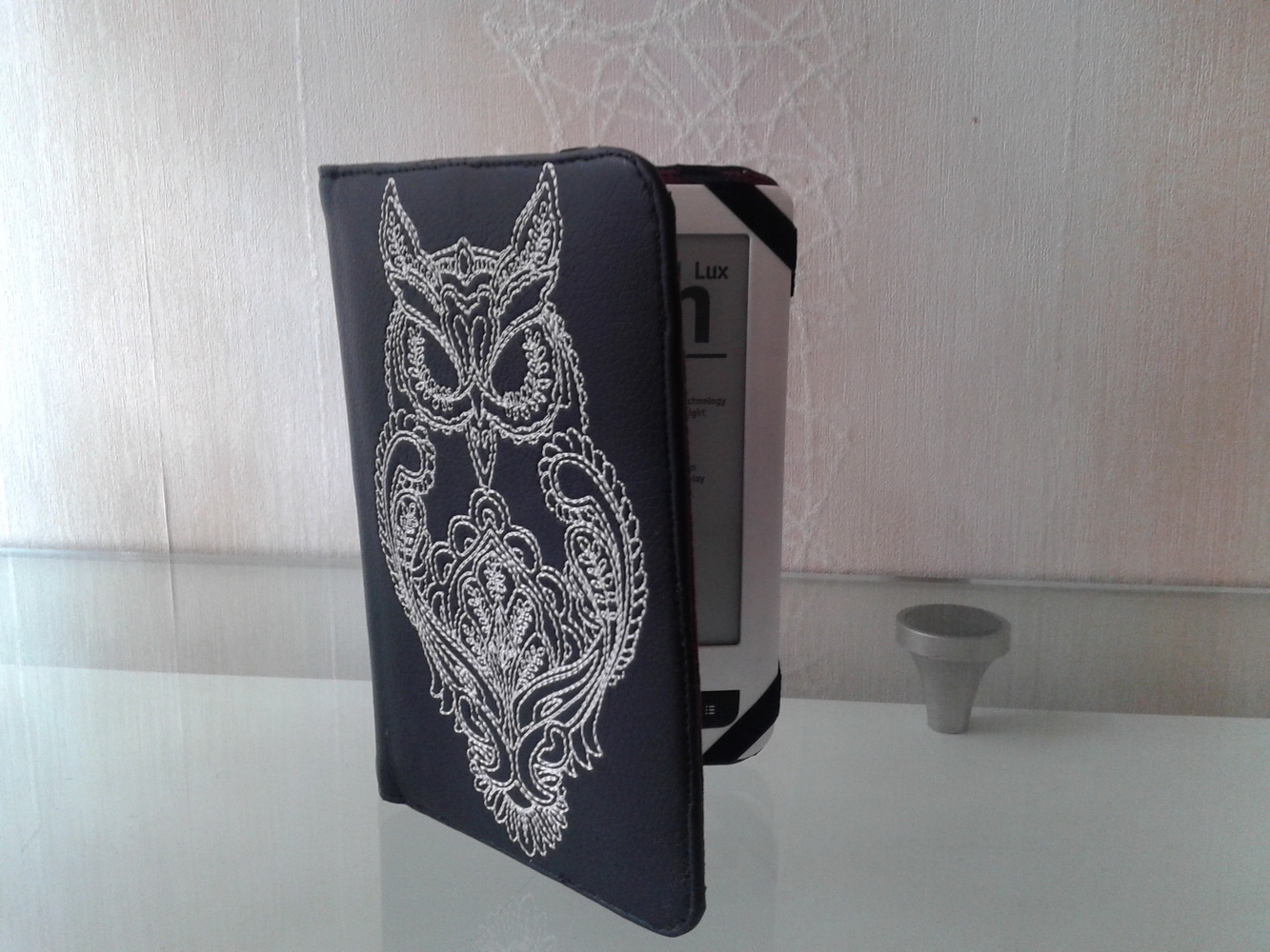 Black cover with embroidered owl design