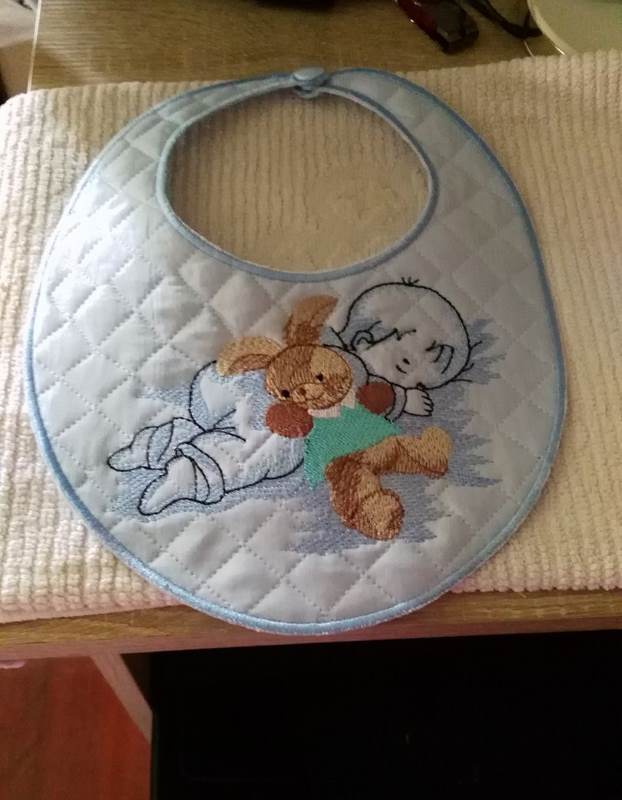 Embroidered baby bib with Baby and bunny toy free design
