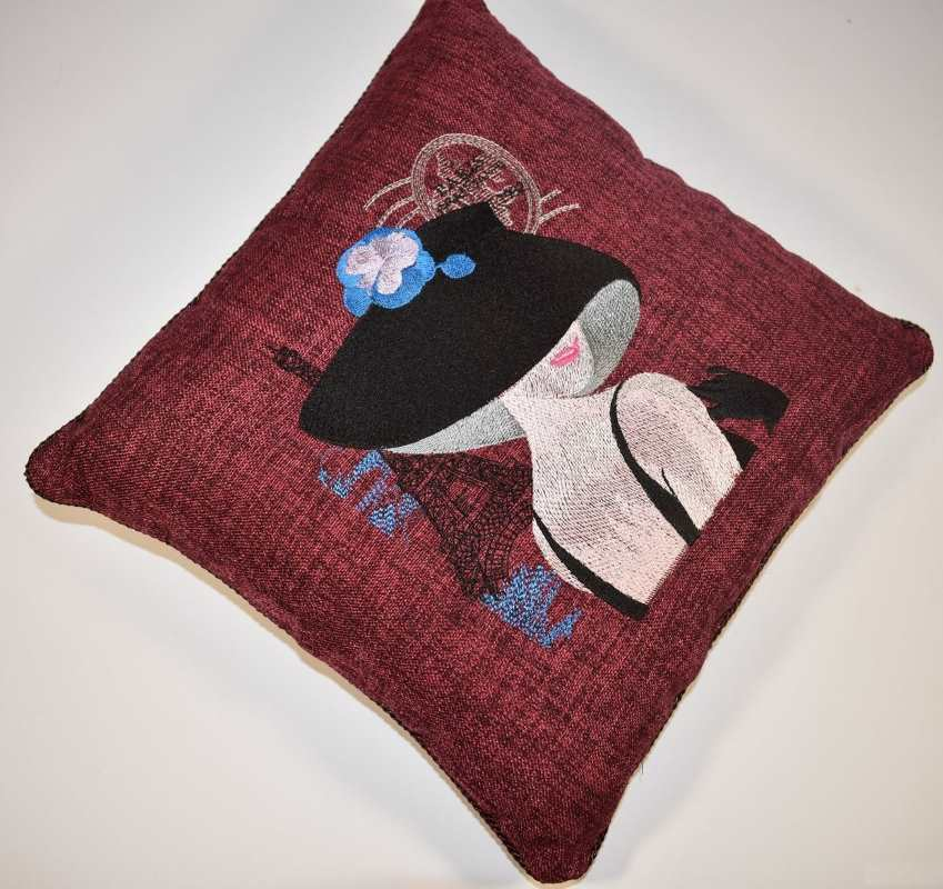Pillow with french woman embroidery design