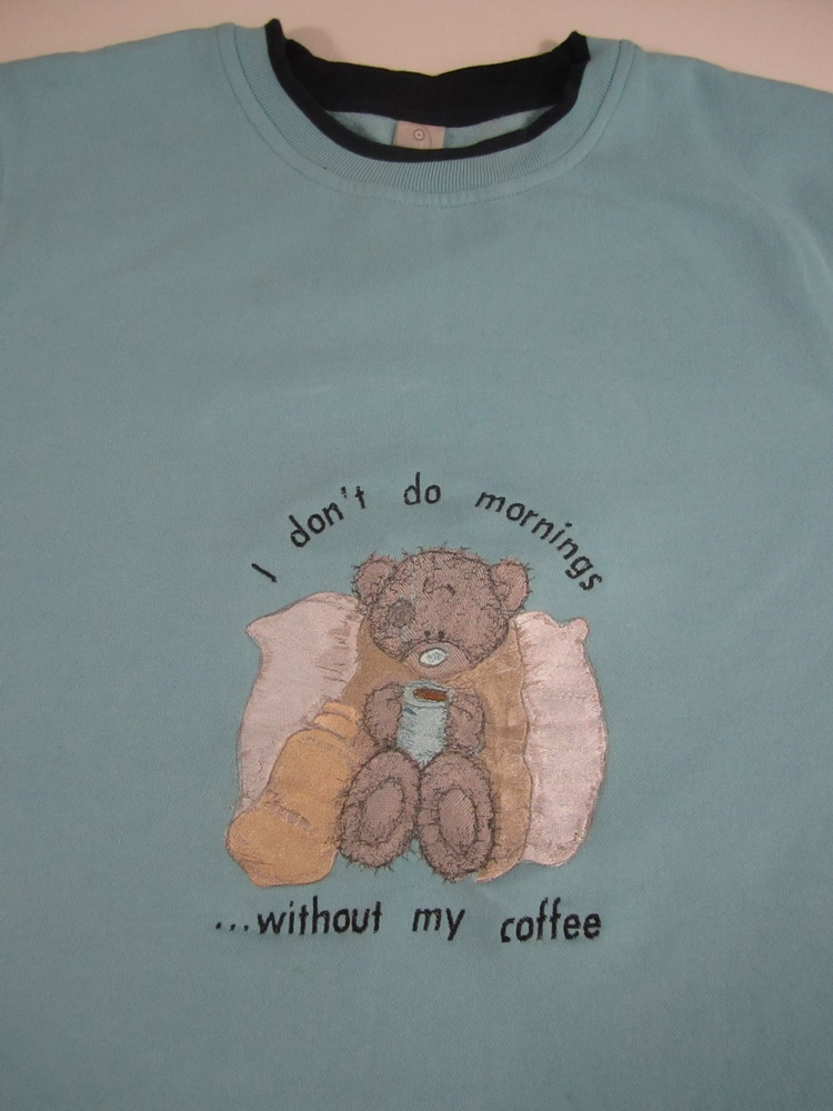 Teddy bear is sick design on embroidered shirt
