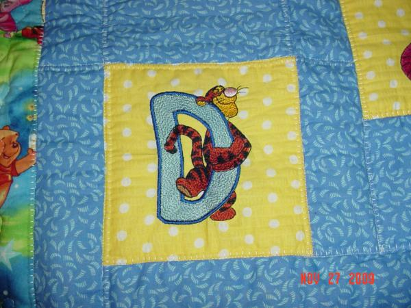 Tigger letter D design on quilt embroidered