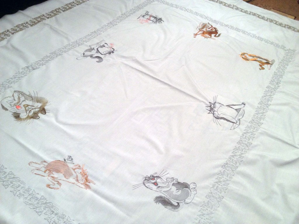 Blanket with cats embroidered designs