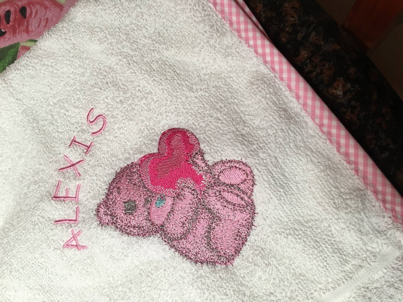 Teddy Bear with a pillow heart design on embroidered towel