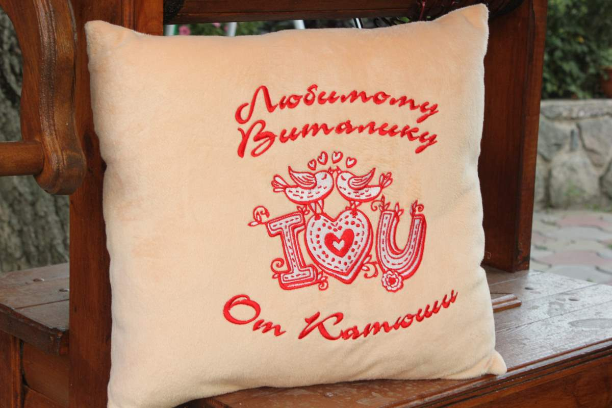 Cushion with i love you embroidery design
