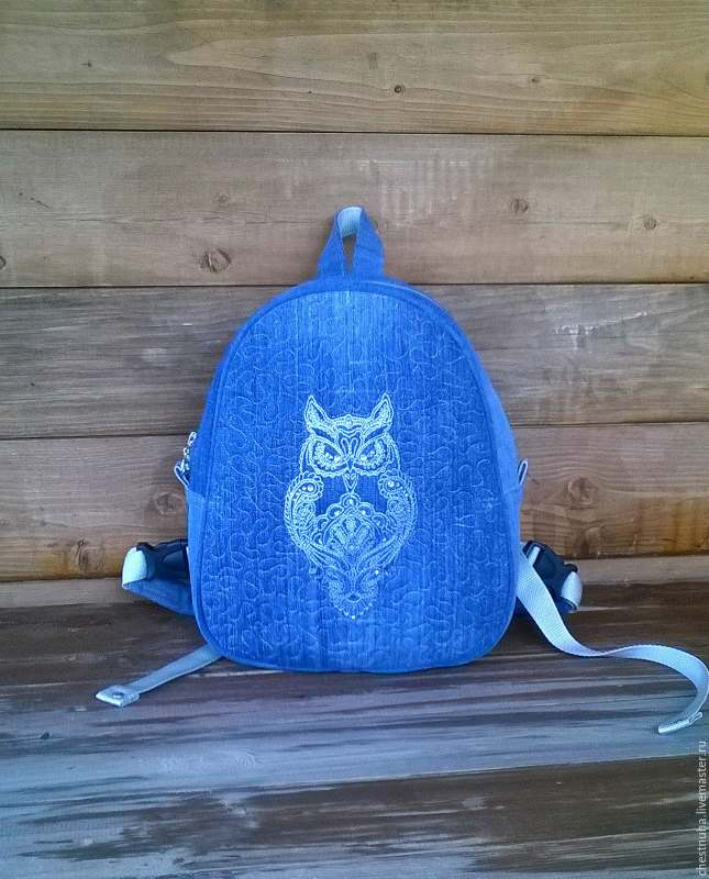 Embroidered denim backpack