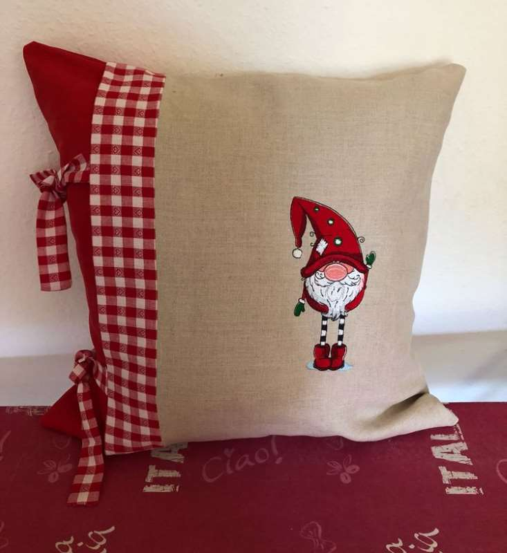 Cushion for winter home with magic embroidery