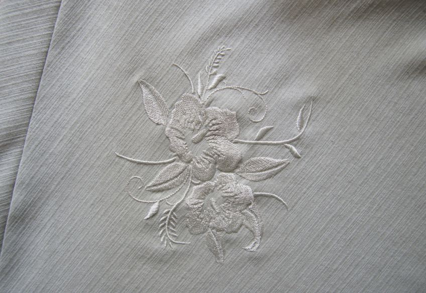 Flowers free machine embroidery design on white fabric