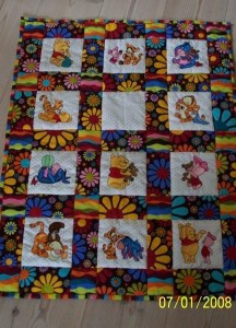 Baby Pooh and friends embroidered on colorful baby quilt