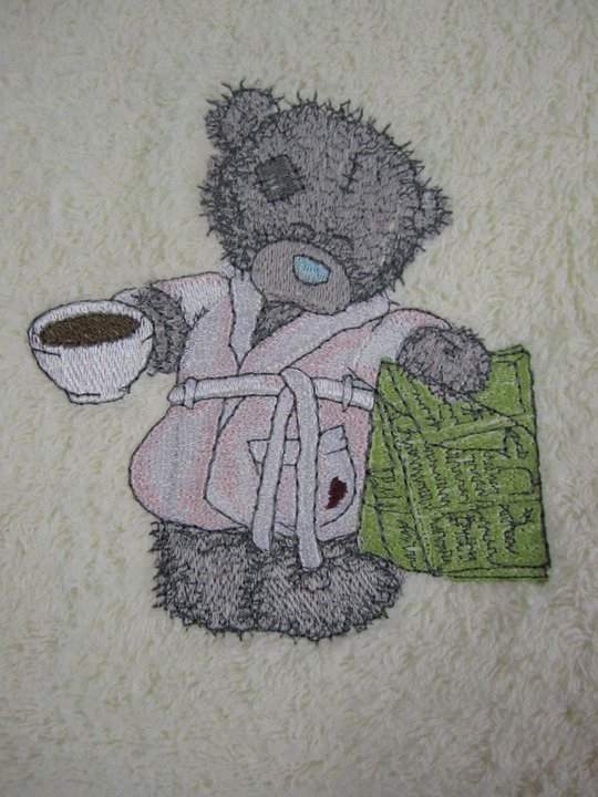 Teddy bear favorite tea and evening newspaper design on embroidered towel