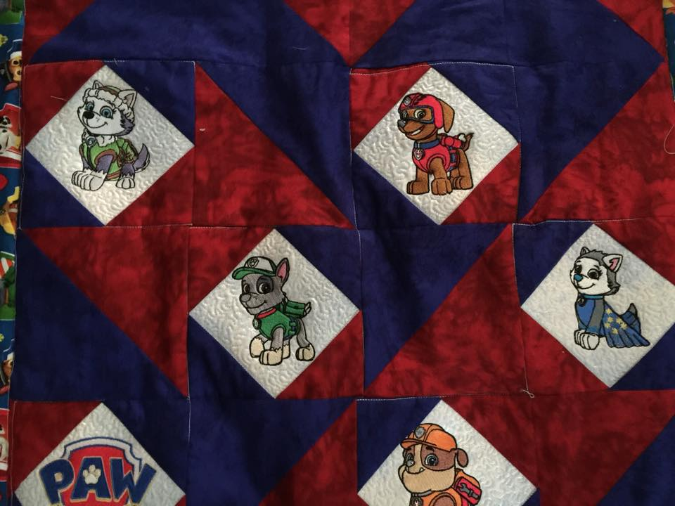 Puppies embroidered on baby quilt