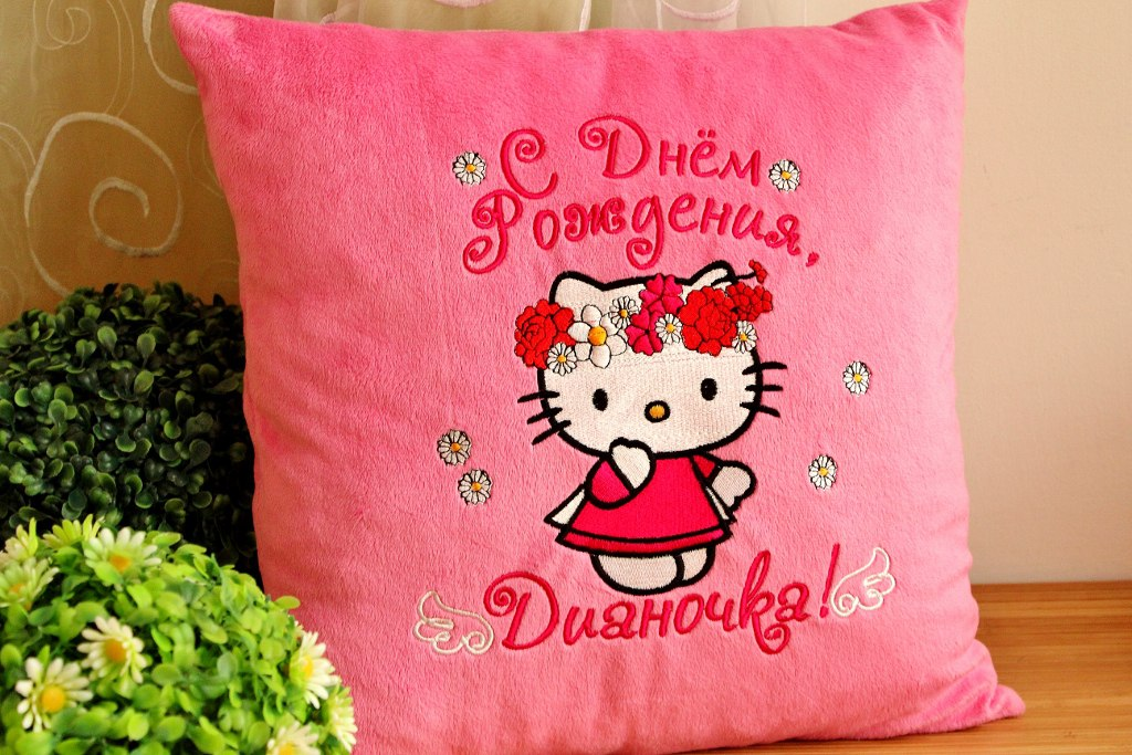 Pink pillowcase with embroidered Hello Kitty on it