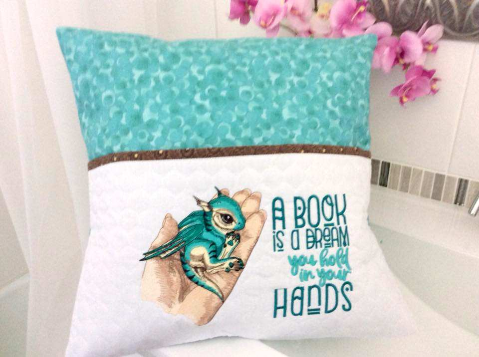 Cushion with cute small dragon embroidery design