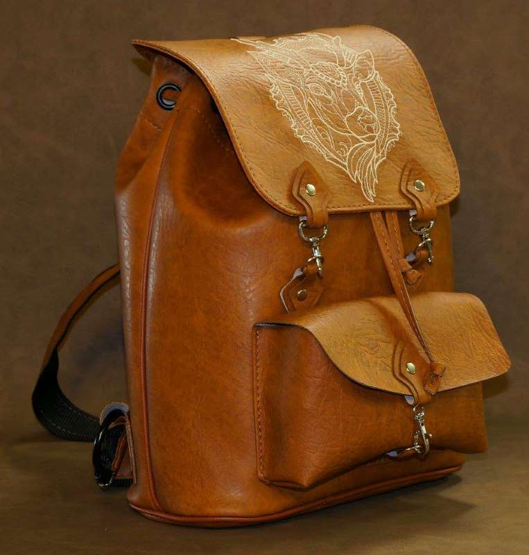 Embroidered leather backpack with deer head design