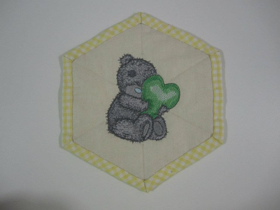 Teddy bear with a pillow in the form of heart design embroidered