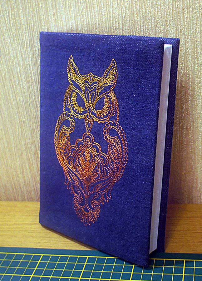 Owl blend design on cover embroidered