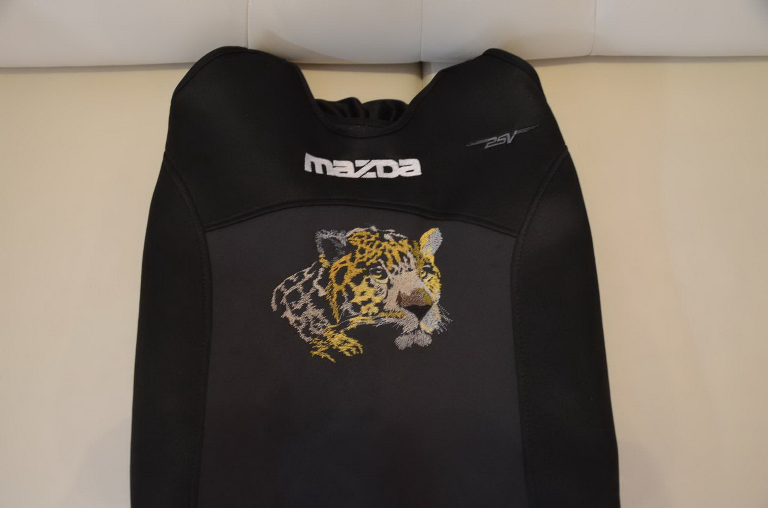 Embroidered Jaguar on cover