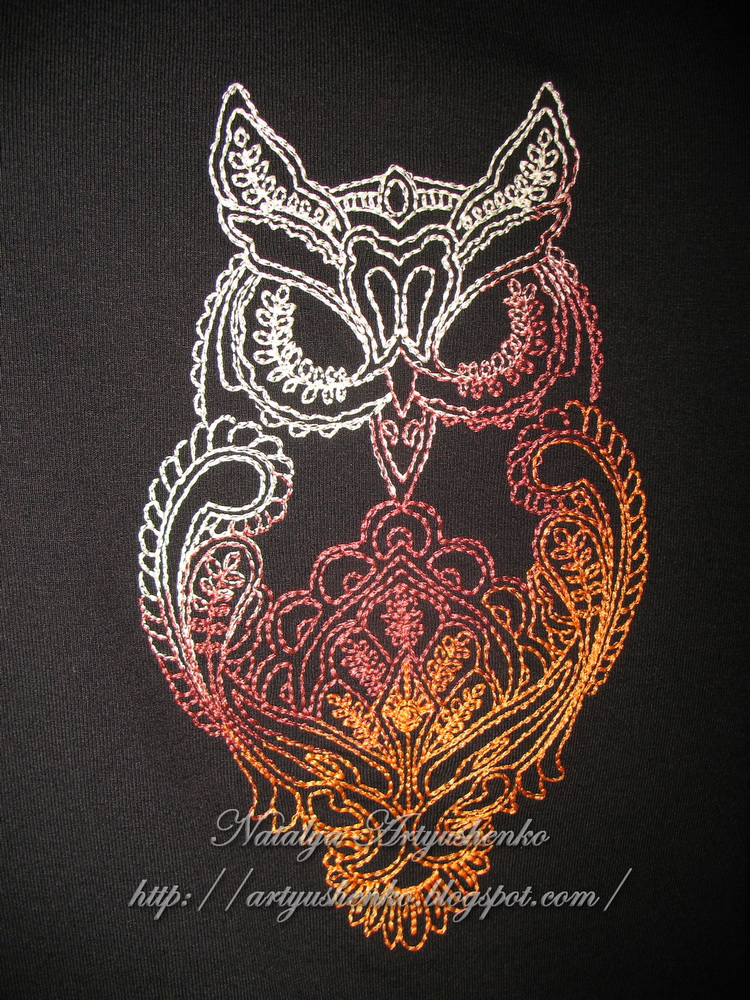Black blouse with embroidered owl on it