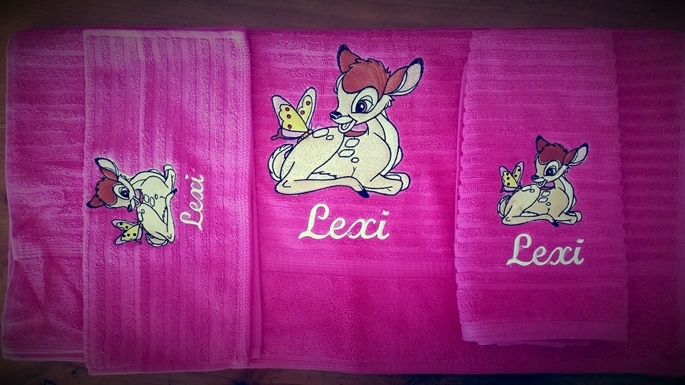 towel with Bambi and butterfly embroidery design