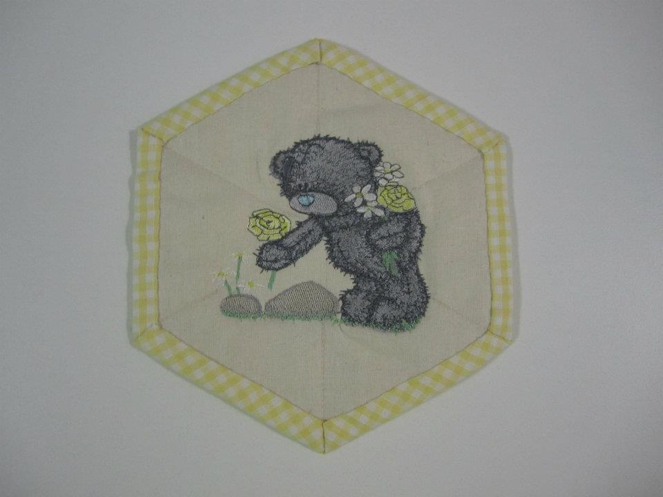 Teddy bear collects flowers design embroidered