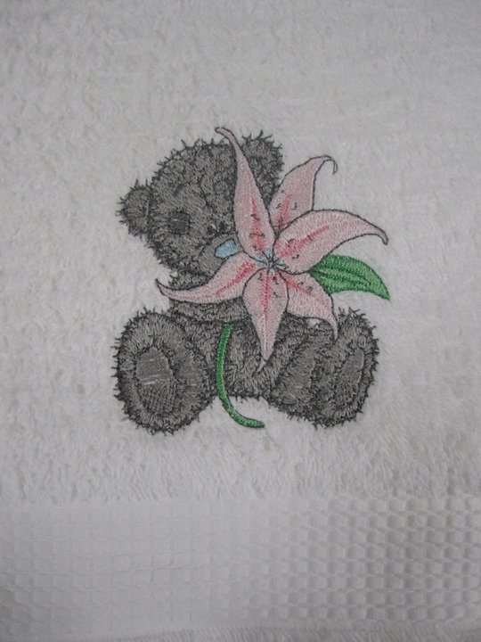 Embroidered bear with lily design on towel