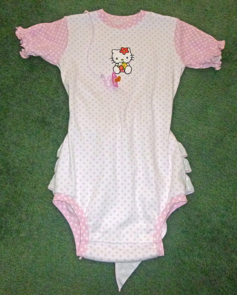 Hello Kitty with sea of flowers embroidery design on babywear