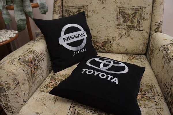 Toyota and Nissan logos on pillowcases embroidered