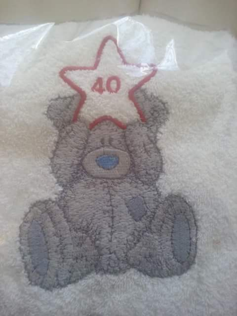 Teddy Bear with star design on embroidered towel