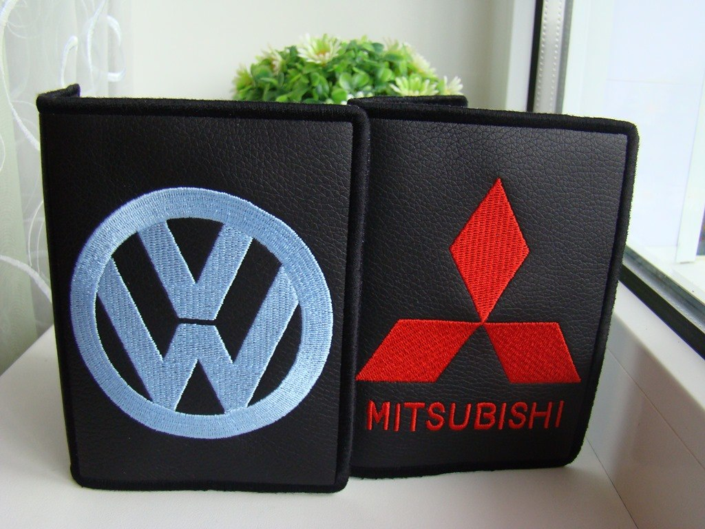 Mitsubishi motors and Volkswagen logos embroidered on covers