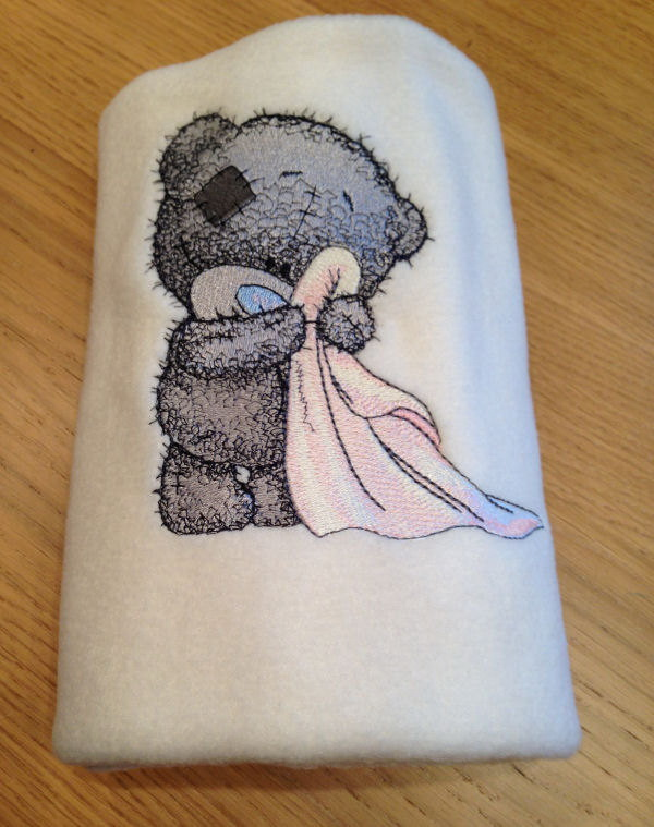Embroidered towel with very cute blue nose bear design