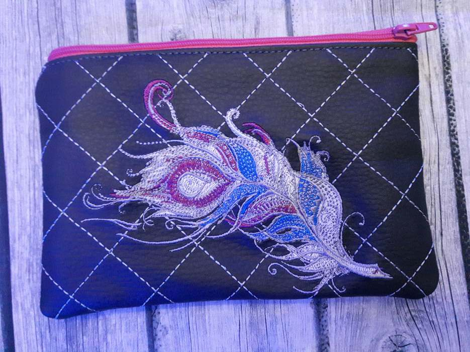 small bag with feather embroidery design