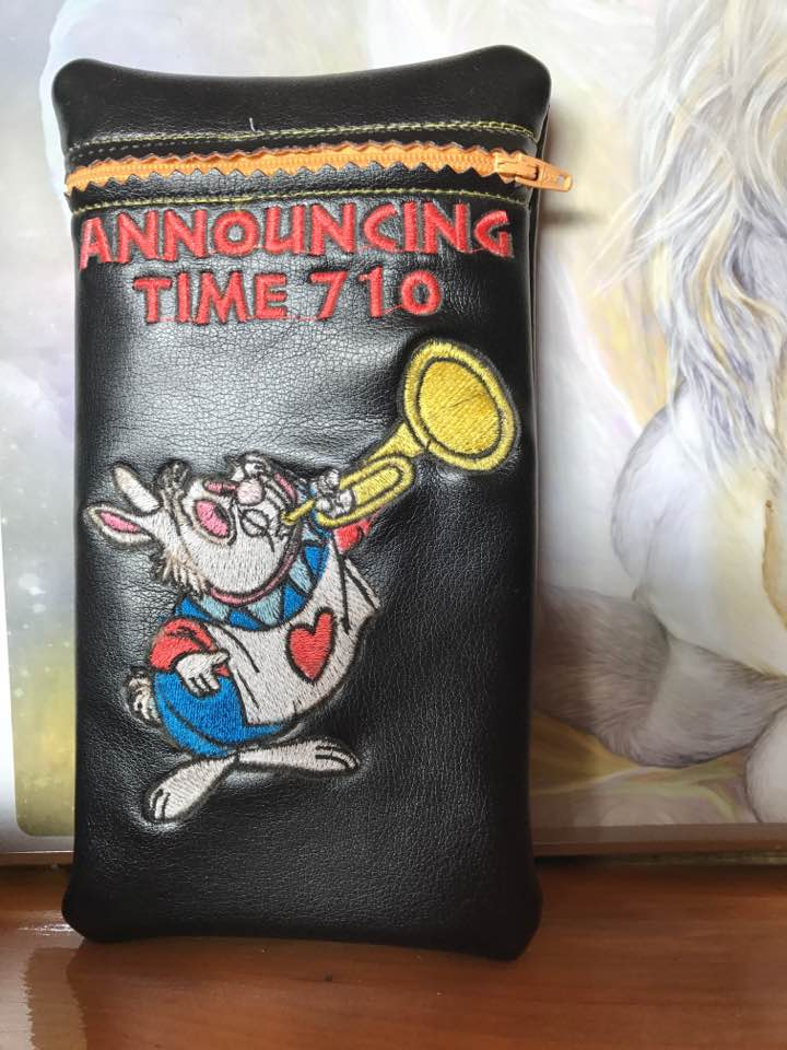 Leather case with White Rabbit plays trumpet design