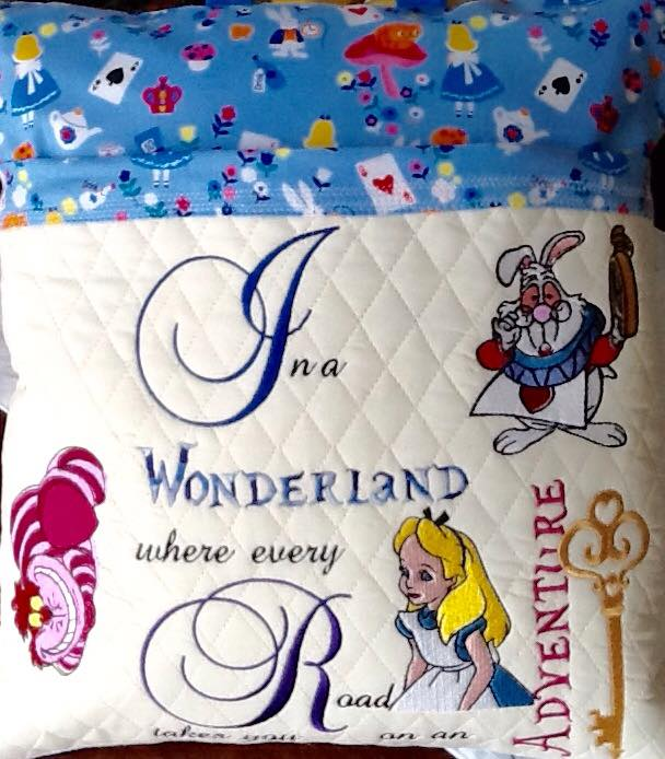 Cushion with Alice in Wonderland embroidered designs