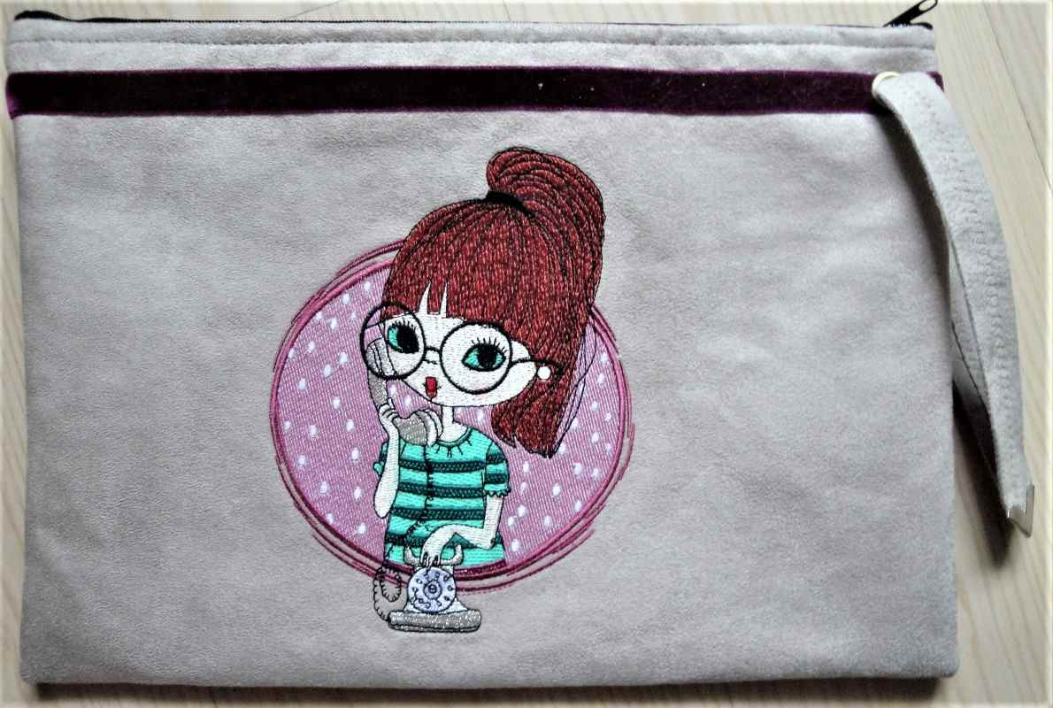 Embroidered purse with calling girl design