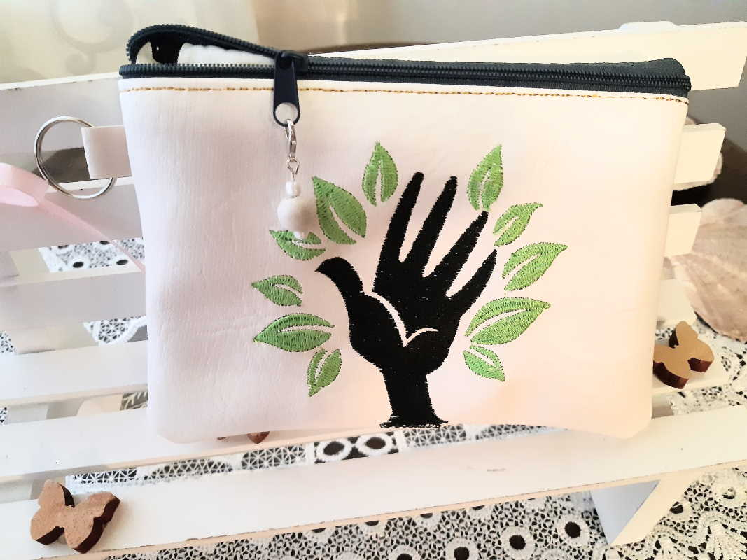 Handbag with hand symbol free embroidery design